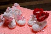Baby little shoes on carpet pink — ストック写真