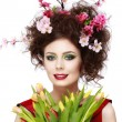 Beauty Spring Girl with Flowers Hair Style. Beautiful Model woma — Stock Photo #67730917