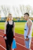A beautiful young couple resting after running — Stock Photo