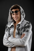 Portrait of a young man with swimming goggles on black backgroun — Stock Photo