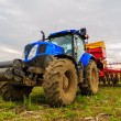 Agricultural work plowing land on a powerful tractor — Stock Photo #73093491