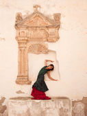 Flamenco and old church — Stock Photo
