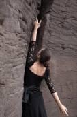 Flameco dancer in a basalt ravine — Stock Photo