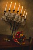 Candles, candle holders, bouquet, wedding bouquet, puzzle, beautiful candle holder, dusk, chest of drawers, antique — Stock Photo