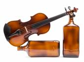 Figurative composition of the bottles with a violin on a white background — Stock Photo