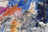 一位艺术家调色板上的油彩的抽象背景 — 图库照片