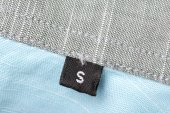 The tag size designation of clothes with the letter S — Stock Photo