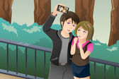 Couple taking a selfie picture of themselves — Stock Vector