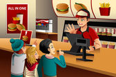Kids ordering food at a restaurant — Stock Vector