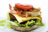 Cheeseburger with bacon — Stock Photo