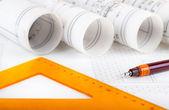 Architecture rolls architectural plans project architect blueprints — Stock Photo