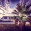 Camper van parked on a beach — Stock Photo #53237507
