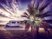 Camper van parked on a beach — Stock Photo