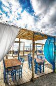 Greek tavern on beach — Stock Photo