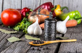 Organic food background Vegetables pepper mill — Stock Photo