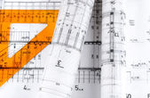 Architecture rolls architectural plans project architect blueprints — Stock Photo