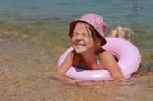 Little girl in panama swiming — Stock Photo