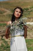 Greek woman in ancient town — Stock Photo