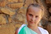Little girl holding a Greek amphora — Stock Photo
