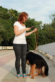 Woman and dog outdoor — Stock Photo