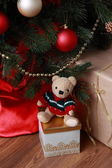 Lovely toy bear over presents on Christmas theme — Stock Photo