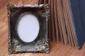 Photo frame on old table — Stock Photo