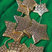 Golden stars over green background — Stock Photo