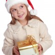 Lovely child in a Santa hat is happy and laughs — Stock Photo #60688317