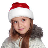 Holiday portrait of a cheerful girl with a Santa's hat — Photo