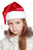 Holiday portrait of a cheerful girl with a Santa's hat — Stockfoto