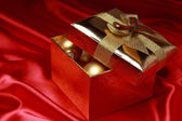 Golden glass decorationsas a present on Holiday theme — Stock fotografie