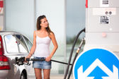 Woman refueling her car in a gas station — Stock Photo