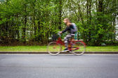 Motion blurred female biker — Stock Photo