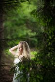 Lovely bride in a forest — Stock Photo