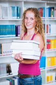 College student female college student in a library — Stock Photo