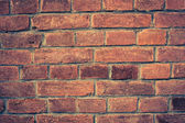 Weathered red brick wall background — Stock Photo