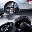 Inside a garage - changing wheels or tires — Stock Photo #61252293