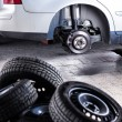 Inside a garage - changing wheels or tires — Stock Photo #61252341