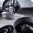 Inside a garage - changing wheels or tires — Stock Photo #61252371
