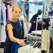 Female shopper in a clothing store — Stock Photo