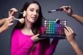 Make-up artist holding her vast palette of colors — Stock Photo
