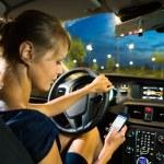 Woman driving a car at night — Stock Photo #61565019
