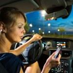Woman driving a car at night — Stock Photo #61565031