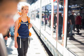 Woman in a train station — Stock Photo