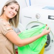 Woman doing laundry — Stock Photo #62098649