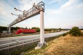 Truck passing through a toll gate on a highway — Stock Photo