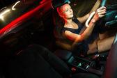 Woman driving a car at night — Stock Photo