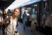 Woman boarding a train or having arrived to her destin — Stock Photo
