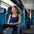 Woman traveling by train — Stock Photo #63726073