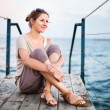 Woman on a jetty at the seacoast — Stock Photo #63726085